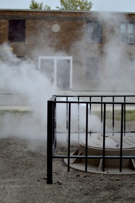 Throughout the development vents such as these spew hot steam. The management of the Lathrop homes says it's not dangerous: http://www.wbez.org/series/curious-city/question-answered-why-steam-coming-out-ground-lathrop-homes-104431