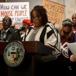 Cheryl Johnson, lifelong Altgeld Gardens resident speaks at the press conference at City Hall (Maya Dukmasova)