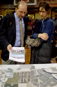 Richard Wheelock (right) examines model of Cabrini-Green neighborhood with Chicago Housing Initiative Executive Director Leah Levinger (Maya Dukmasova)